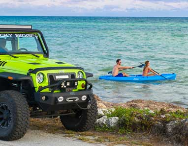 Couple kayaking the ocean on with a rental package