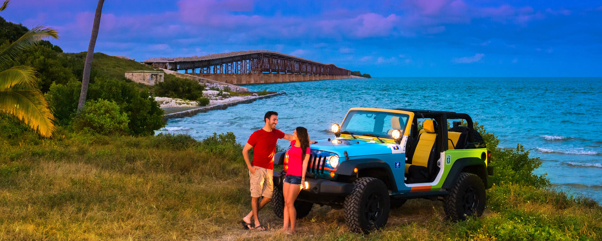 Couple with a Jeep at dusk near the Old 7 mile bridge