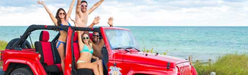 Friends celebrating with a Jeep convertible