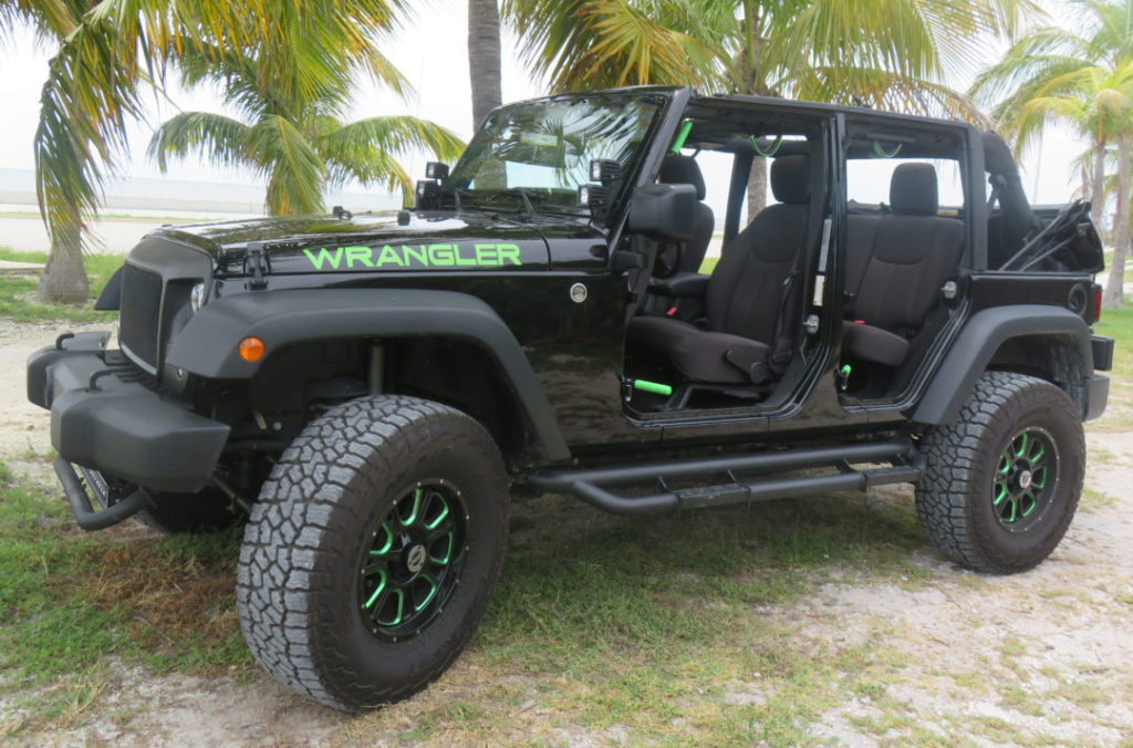 Lifted Black and Green Wrangler
